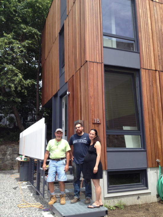 (from left) Contractor Tim Alaric and metal fabricator Aaron Legg pose with client and homeowner Hansy Better Barraza on July 17. (Gazette Photo by Rebeca Oliveira)